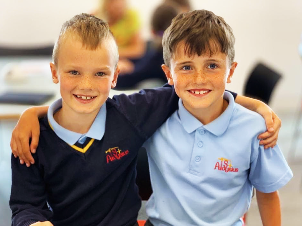 pupils with arms around each other